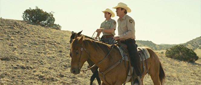 Deputy Wendell (Garret Dillahunt) accompanies Sheriff Ed Tom Bell on horseback.