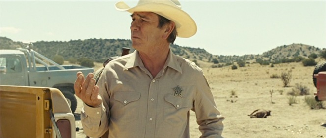 "Wendell: ""It's a mess, ain't it, Sheriff?"" Ed Tom: ""If it ain't, it'll do till the mess gets here."""