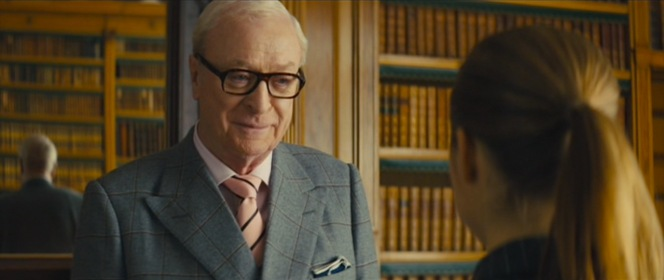 "Arthur's preferred neckwear inverts the standard Kingsman club tie, perhaps denoting his elevated position in the bureau or signaling something more sinister... Ian Fleming would also agree that Arthur's choice of a wide Windsor tie - ""the mark of a cad"" - should indicate something untrustworthy lurking beneath."