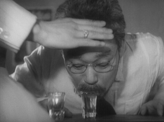 "The titular ""drunken angel"", Dr. Sanada (Takashi Shimura)... doing what he does best."