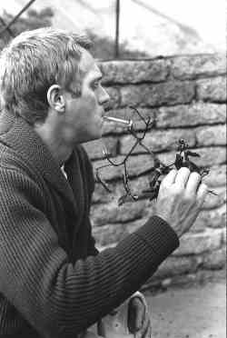 Steve lights a joint at Big Sur. Note his cardigan's shaker-stitch. (Photograph by William Claxton, 1964)