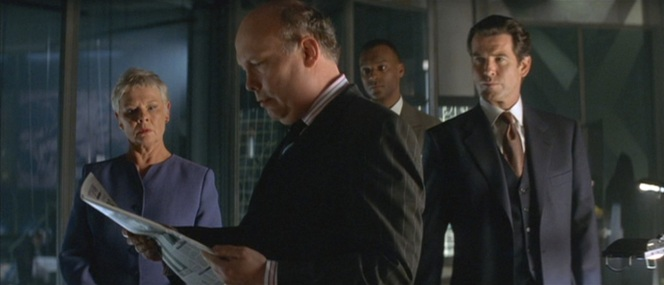Bond gets briefed on the Carver situation by his MI6 colleagues.