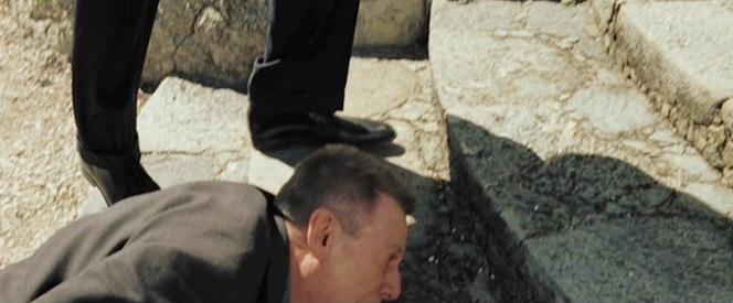 Bond is carefully not to step on the wounded Mr. White after shooting him down on the steps of Lake Gaeta.