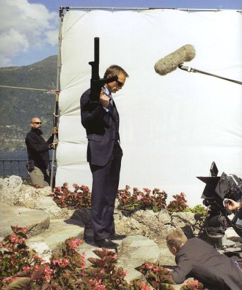 Daniel Craig on location in Italy, suited up and suitably armed as James Bond in Casino Royale (2006). Photo by Greg Williams.