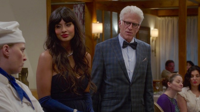 """Tahani (Jameela Jamil) and Michael (Ted Danson) dressed in their fineries for the opening of The Good Plates in """"Jason Mendoza"""" (episode 1.04)."""
