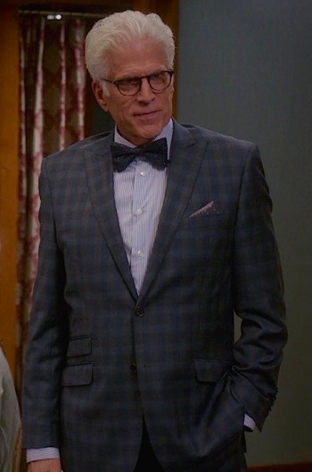 He wears the same suit, pocket square, and shoes, but this earlier episode features a blue bengal-striped shirt and a sparkly navy bow tie... slightly different from the solid light blue shirt and peacock bow tie worn in later episodes.