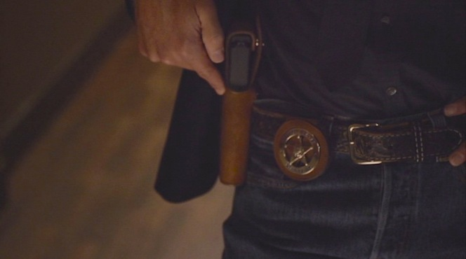 Glock and badge: the tools of Raylan's trade.