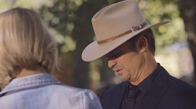 """Raylan consults with Ava (Joelle Carter) for his 1:30 """"haircut""""."""