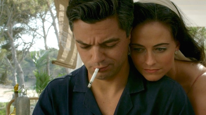 Ann (Lara Pulver) looks over Fleming's manuscript in Fleming: The Man Who Would Be Bond. Note the three rings on Fleming's cigarette, a personal trademark that he would also pass along to 007.