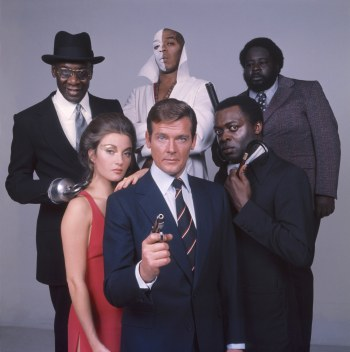 Roger Moore poses with Live and Let Die castmates, from clockwise: Janey Seymour, Julius Harris, Geoffrey Holder, Earl Jolly Brown, and Yaphet Kotto.
