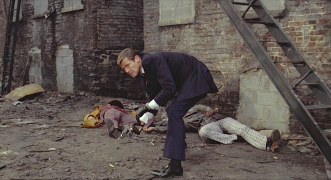 Bond's black socks are an acceptable choice, though a navy or dark blue would better continue the leg line from the trousers... though with a classic outfit like this, who am I to criticize anything?