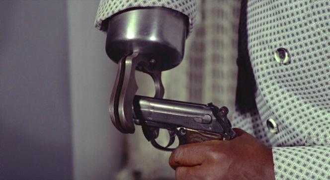 Bond's PPK in this scene was modified with a thinner metal frame from the trigger guard forward to make it easier for Tee-Hee's hook to bend the barrel.