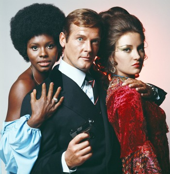 Gloria Hendry, Roger Moore, and Jane Seymour in a promotional photo for Live and Let Die (1973)