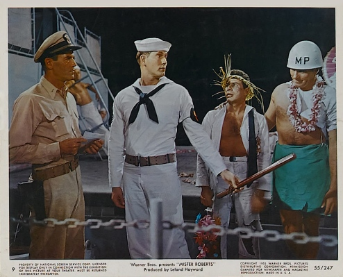 Lobby card from Mister Roberts (1955), featuring Henry Fonda's Lt.(j.g.) Doug Roberts armed with a .45.