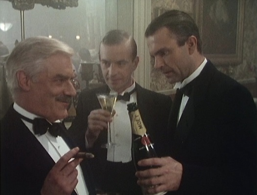 Reilly tops off glasses for his spymaster chief Mansfield Smith-Cumming (Norman Rodway) and fellow agent R.H. Bruce Lockhart (Ian Charleson). The real Lockhart is often credited with keeping Reilly's legend alive through the mostly fictionalized biography Reilly: Ace of Spies that formed the basis for this miniseries.