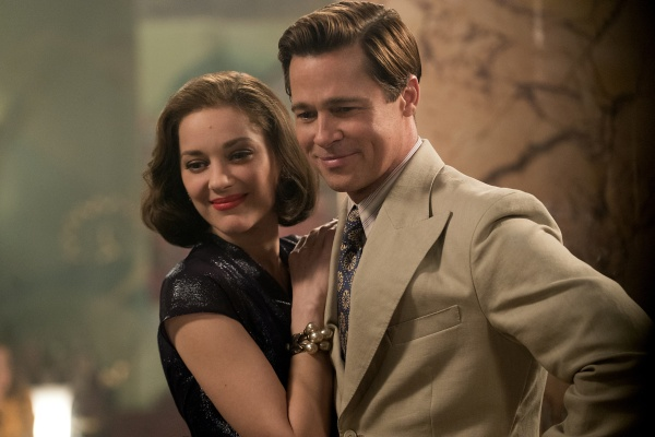 Production photo by Daniel Smith of Marion Cotillard and Brad Pitt in Allied (2016). Note the edge stitching on Max's wide suit jacket lapels.