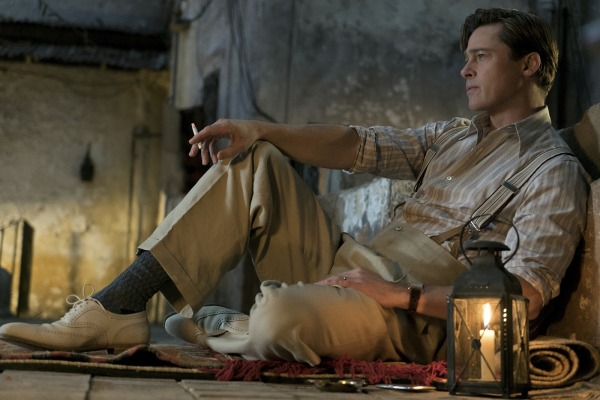 Production photo by Daniel Smith of Brad Pitt in Allied (2016), reclining on the roof of his character's apartment building in Casablanca.