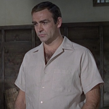 Tan linen camp shirt in You Only Live Twice (1967), worn with brown linen trousers and brown leather sandals.