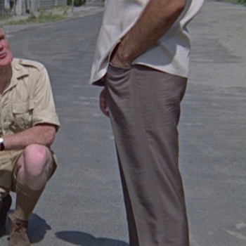 Brown linen trousers in You Only Live Twice (1967), worn with tan linen camp shirt and brown leather sandals.