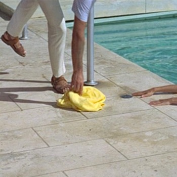 Brown leather sandals in Thunderball (1965), featured on screen as Bond hands Domino's yellow towel to her.