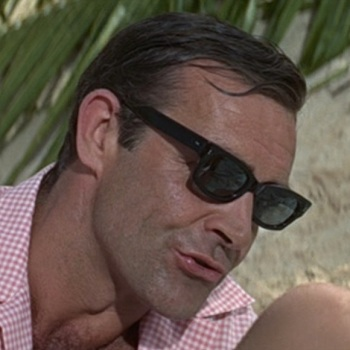 Sean Connery sports a pair of black rectangular-framed sunglasses in Thunderball (1965)