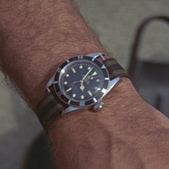 825b6f0ce6d Sean Connery wears 007 s classic Rolex Submariner 6538 on a striped NATO  strap in Thunderball (