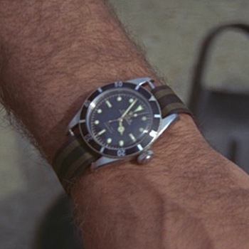 Sean Connery wears 007's classic Rolex Submariner 6538 on a striped NATO strap in Thunderball (1965), just as he had the previous year in Goldfinger (1964).