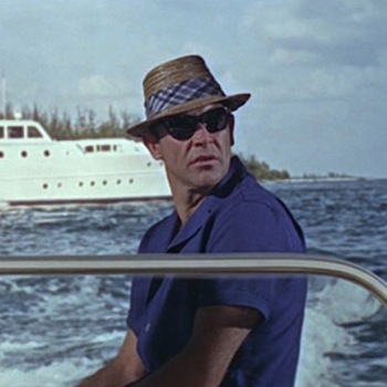 Straw hat and sunglasses in Thunderball (1965), worn with Bond's ill-advised matching blue shirt and pants combo.