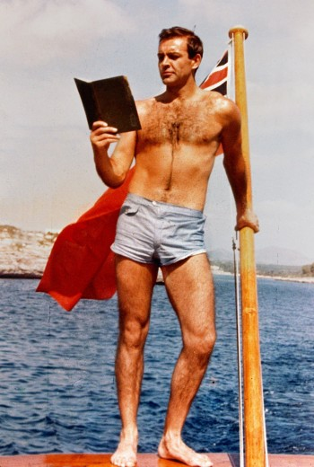 Even Sean Connery doesn't let an exotic island location interfere with his reading plans! The light blue trunks he wore for this photo session inspired Sunspel to create its first swim shorts for men.