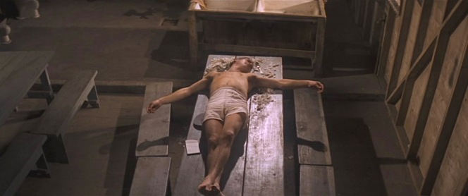 """In case you missed the film's Christian allegories, consider this screenshot of Luke, clad only in his boxers as he lays outstretched in a crucifixion-like pose. (Reportedly, Paul Newman only had to eat about eight of the """"fifty eggs"""", but he still vomited in a trash can immediately after director Stuart Rosenberg called """"cut!"""")"""