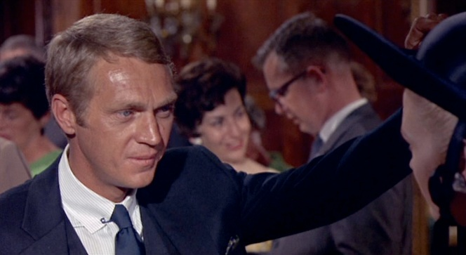 Note the navy printed silk pocket square that echoes - rather than matches - his solid navy tie.