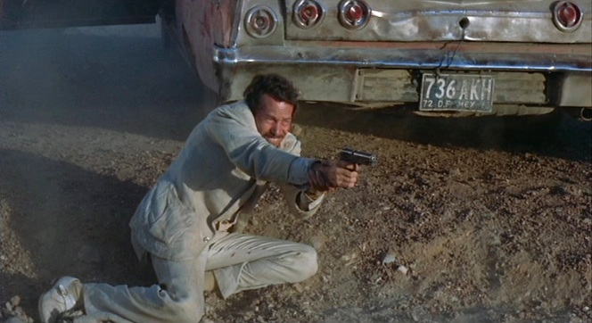 Bennie takes aim during a bullet-riddled confrontation in Mexico.