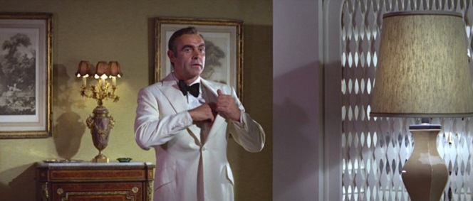 Bond reholsters his PPK, likely to avoid an accidental discharge, upon finding Tiffany in his hotel room.