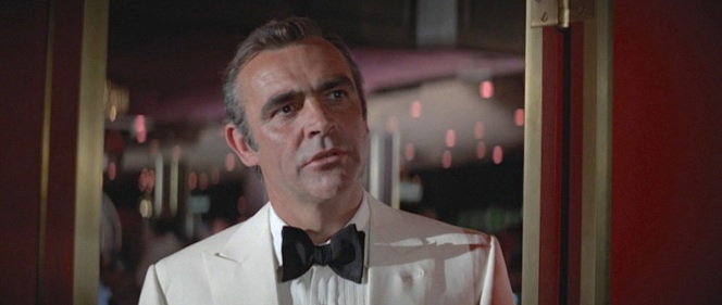 Bond, unimpressed with Shady Tree's schmaltzy burlesque comedy. No wonder his reaction to the comic's death is basically to shrug and go play craps.