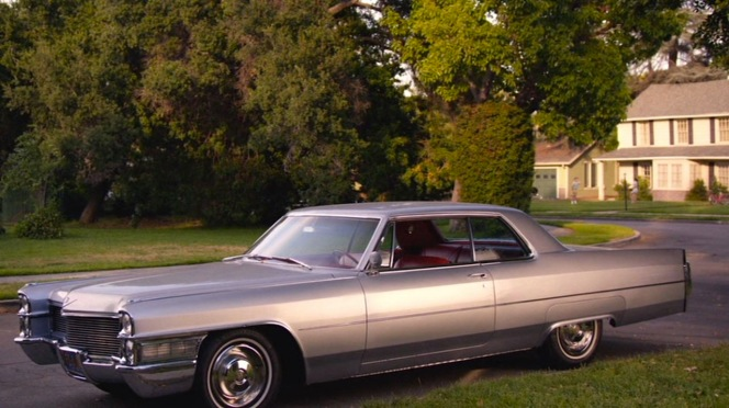 Don's shining Cadillac Coupe de Ville, parked outside the Baur home. Once a symbol of his prestigious status in the New York ad world, it now represents his best shot at freedom from it.