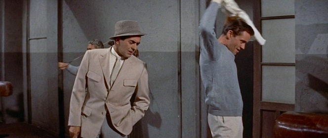 Jake interrupts Cohn's workout.