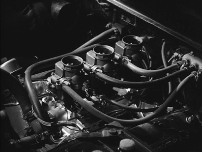 The shot of Luke's engine clearly shows a 312 Thunderbird V8 with three two-barrel carburetors... is this from under the hood of the '51 Ford or the '57 Ford that we see later?