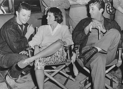 This behind-the-scenes photo of James Mitchum, Keely Smith, and Robert Mitchum best shows the work boots that the latter occasionally wore as Luke Doolin.