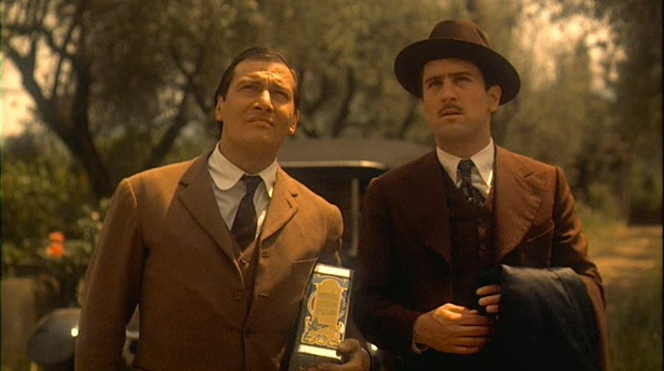 Olive oil in hand, Don Tommasino and Vito Corleone pay a house call on the decrepit Don Ciccio.