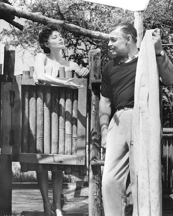 Ava Gardner and Clark Gable on set and in character during filming of Mogambo. His character is unreasonably upset after finding her using his shower.