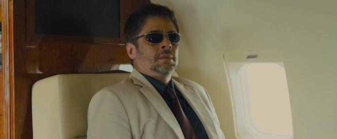 Alejandro takes his seat on the plane.