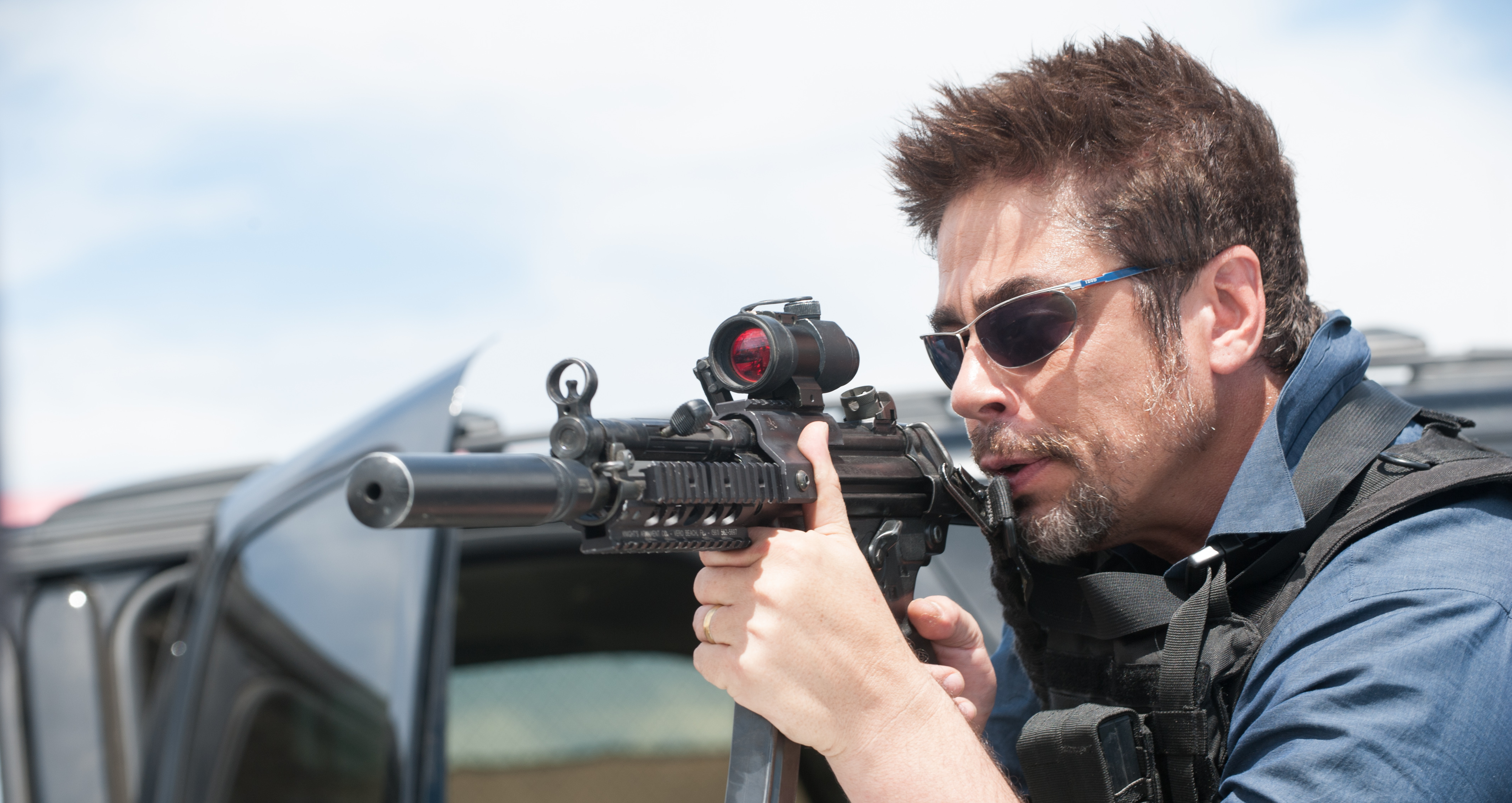 73b786009f Production photo of Benicio del Toro taking aim with a suppressed Heckler    Koch MP5A3 in