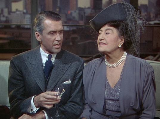 Rupert works his charm on Mrs. Atwater (Constance Collier).
