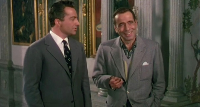 Count Vincenzo Torlato-Favrini (Rossano Brazzi) makes the acquaintance of Maria's old pal, Harry Dawes. Harry's casual American attire provides a sartorial contrast to the continental count, who is always composed in a fashionable gray suit and tie.