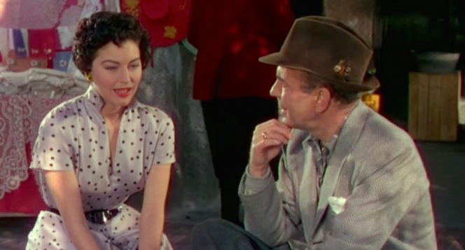Harry eagerly catches up with Maria. If I were having a conversation with Ava Gardner, I'd probably be hanging on to every word as well.