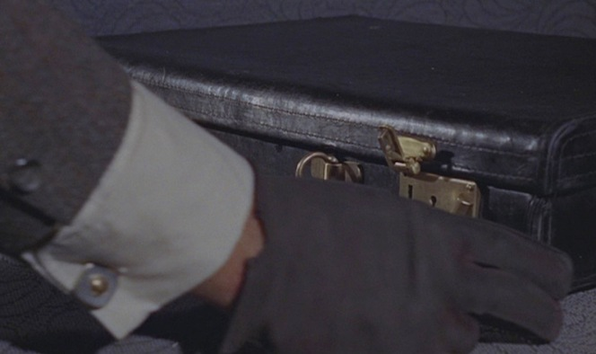 The pale blue-gray shirting suggests that this pick-up shot featured Robert Shaw (or a stand-in actor costumed as Grant) wearing a different shirt with the suit from this scene. That would explain the blue enamel cuff links returning, although they appear to be worn through the duration of the fight sequence.