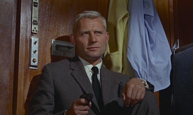 Grant keeps his Llama pointed on Bond during their confrontation on the Orient Express. The suppressor for Bond's Walther PPK sticks out of Grant's breast pocket.