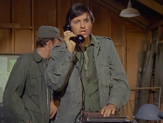 """Bundled up in his field jacket and fatigues during """"The Army-Navy Game"""" (Episode 1.20)."""