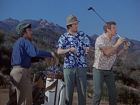OG-107 and aloha shirts on the green in the pilot episode.