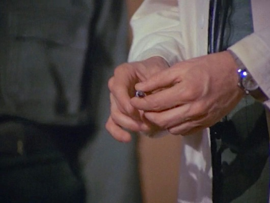 Hawkeye's watch pokes out from under his sleeve in the pilot episode.